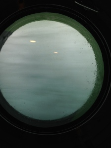 If this looks blurry, it's because it is WATER splashing past our porthole.